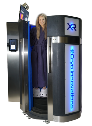 Best Cryotherapy Machines of 2019.  The XR cryosauna by Cryo Innovations with door open and woman standing inside.  Cryotherapy machine.  Liquid nitrogen based cryotherapy machine.