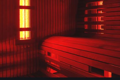 What is Infrared Sauna Therapy?  Infrared Sauna with wooden bench.