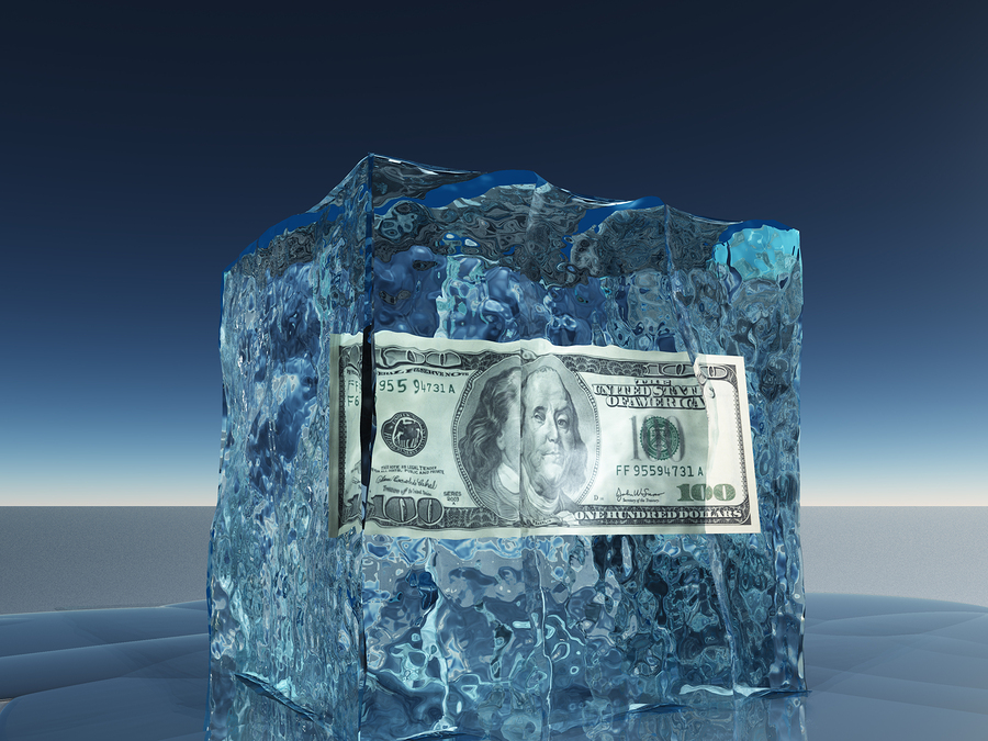 Why is cryotherapy so expensive?  Dollar bill frozen in ice cube.
